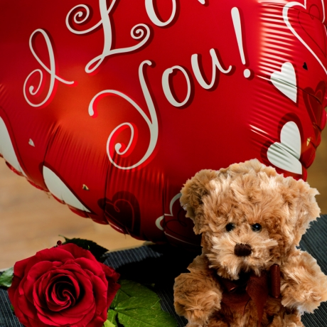 Show them just how much you love them with a fun 18 inch 'I Love You' red heart shaped helium balloon.<BR><BR>The balloon is accompanied by a luxury single red Rose and a cuddly teddy bear eight inches in height. <br /><br />This gift is delivered boxed with your own personal message.