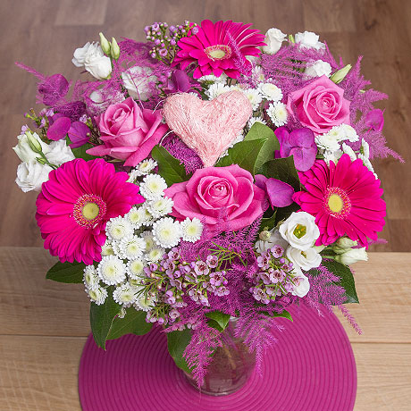 The perfect gift for your loved one, this beautiful bouquet contains an eye-catching selection of pink and white blooms.<br /><br />Stunning pink Aqua Roses are the star feature along with hot pink Gerbera and white Chrysanthemums.<br /><br />A keepsake pink heart pick completes this heartfelt gift!