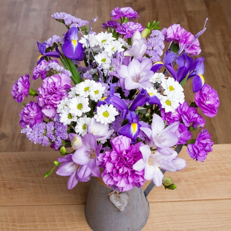 Beautiful blue Iris, lavender Freesias and white Chrysanthemums feature in this wonderful bouquet which is full of Spring charm.<br /><br />Purple Carnations and lavender Statice provide the perfect finishing touch to this lovely arrangement.