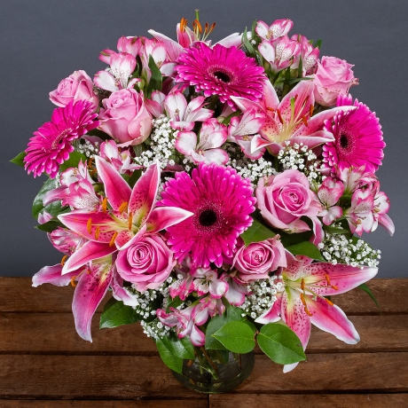 This stunning bouquet featuring pale pink Roses, Oriental Lilies and hot pink Gerbera is sure to add a wonderful splash of colour to the home!<br /> <br />Delicate white Gypsophila and glossy green leaves provide the perfect finish.
