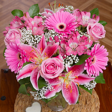 A luxurious bouquet featuring beautiful pale pink Roses and exquisite Oriental Lilies.