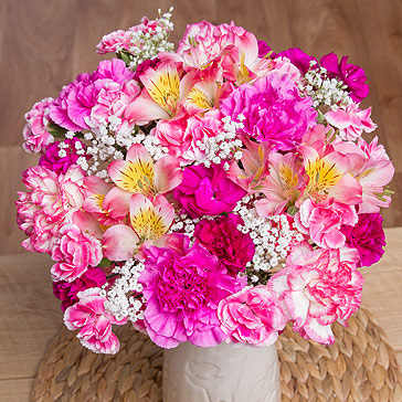 A feminine bouquet bursting with Spray Carnations, Alstroemeria and framed with subtle Gypsophila.