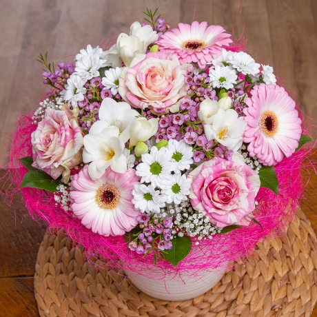 Beautiful pink and white Roses, pink Germini, white Freesias and Chrysanthemums are displayed in a pretty rattan frame.<br /><br /> Finished with pink Wax Flower, white Gypsophila and Salal leaf greenery, this posy needs no arranging - meaning the recipient can display the bouquet straight away!