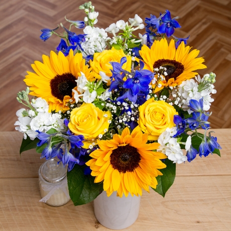 Bold Yellow Moonwalk Roses, pretty white Stocks and stunning Sunflowers star in this wonderful summer bouquet.<br /><br />