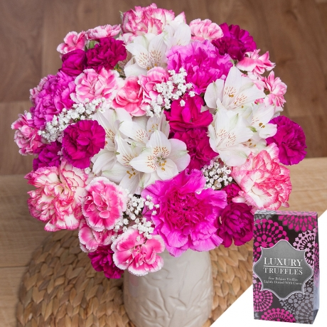 A gorgeous feminine bouquet including white Alstroemeria, two-tone pink and white Carnations, pink Spray Carnations and delicate white Gypsophila.<br /><br />A delicious 110g box of Belgian dusted truffles makes the gift extra special.