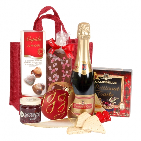 This beautifully presented gift bag is filled with gourmet goodies. A perfect romantic gesture for your loved one.