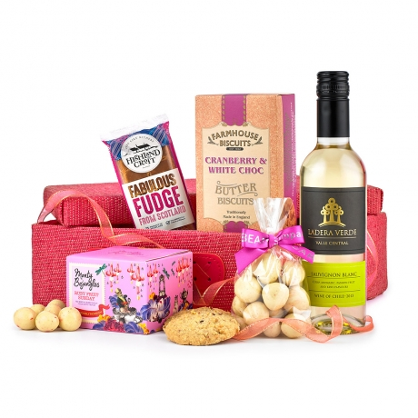 For those who love pink, this gourmet hamper in a pink woven basket will make the perfect tasty treat.