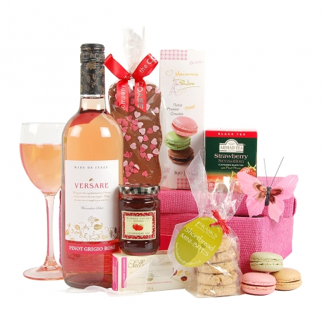 Wonderful sweet Macarons, Shortbread Bites, Cranberry & Almond Nougat and a bottle of Rose Wine are just some of the pleasures awaiting the recipient of this luscious hamper.<br /><br />