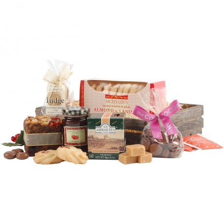 A delicious Mini Cherry & Almond Topped Cake and Handmade Strawberry Jam feature in this enticing gift full of nibbles.<br /><br />