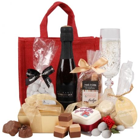 A wonderful celebratory hamper gift featuring wine and chocolates; it will make the perfect birthday gift.
