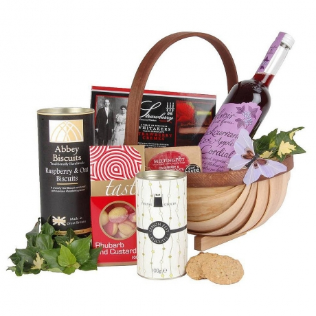 A thoughtful gift idea to convey support to a loved one featuring cordial, biscuits & confectionery.
