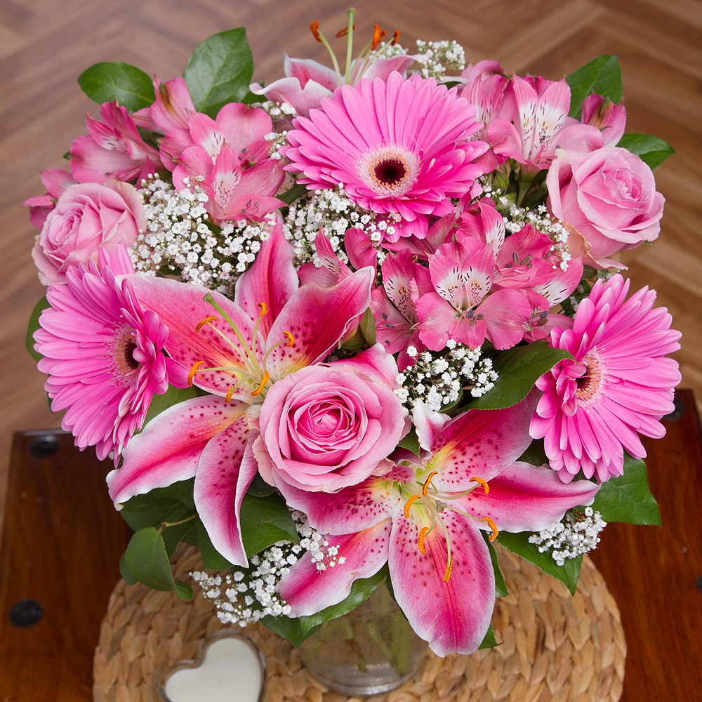 This luxurious bouquet brings with it a wonderful splash of colour and features beautiful pale pink Roses surrounded by exquisite pink Oriental Lilies and hot pink Gerbera.<br /> <br />Glossy Salal leaf and white Gypsophila provide a lovely contrast to the shades of pink and give the arrangement a fairytale finish.