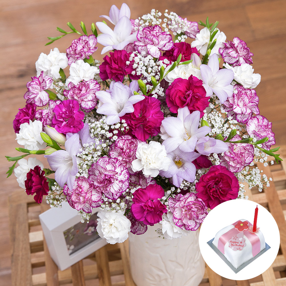 A beautiful birthday gift featuring a charming flower arrangement and a delicious miniature birthday cake.<br /><br />Lilac Freesias are joined by a delightful mix of purple, white and purple-edged Spray Carnations and white Gypsophila provides the perfect finishing touch.