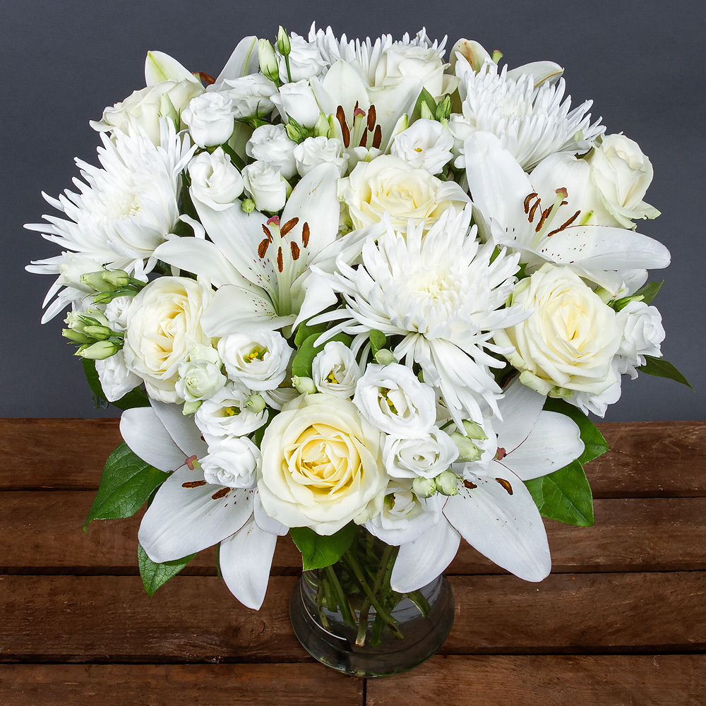 A striking arrangement of beautiful white Roses complemented by Lisianthus and Asiatic Lilies.