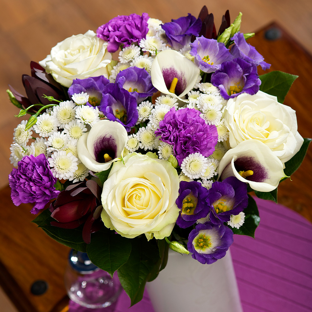 A truly luxurious arrangement of exquisite white Avalanche Roses, elegant purple-centred Calla Lilies and Moonlight Carnations.<br /><br />Lavender Lisianthus, white Chrysanthemums and Dracaena & Salal leaves provide the perfect finish to this beautiful bouquet.