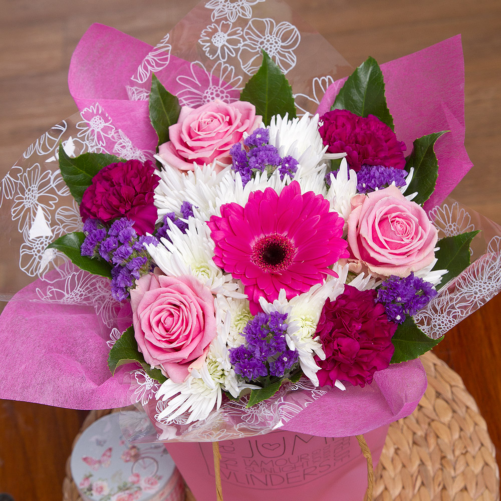 Gorgeous pink Aqua Roses are surrounded by wonderful Anastasia Spray Chrysanthemums, pink Germini and deep purple Carnations.<br/><br/>