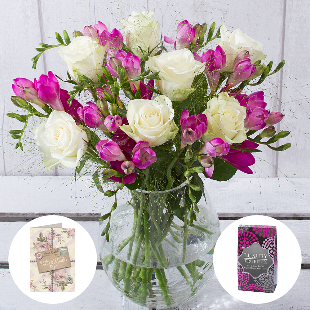 Treat your loved one on their special day with this thoughtful birthday gift which includes a scented bouquet of gorgeous white Roses and pretty pink Freesias.<br/><br/>