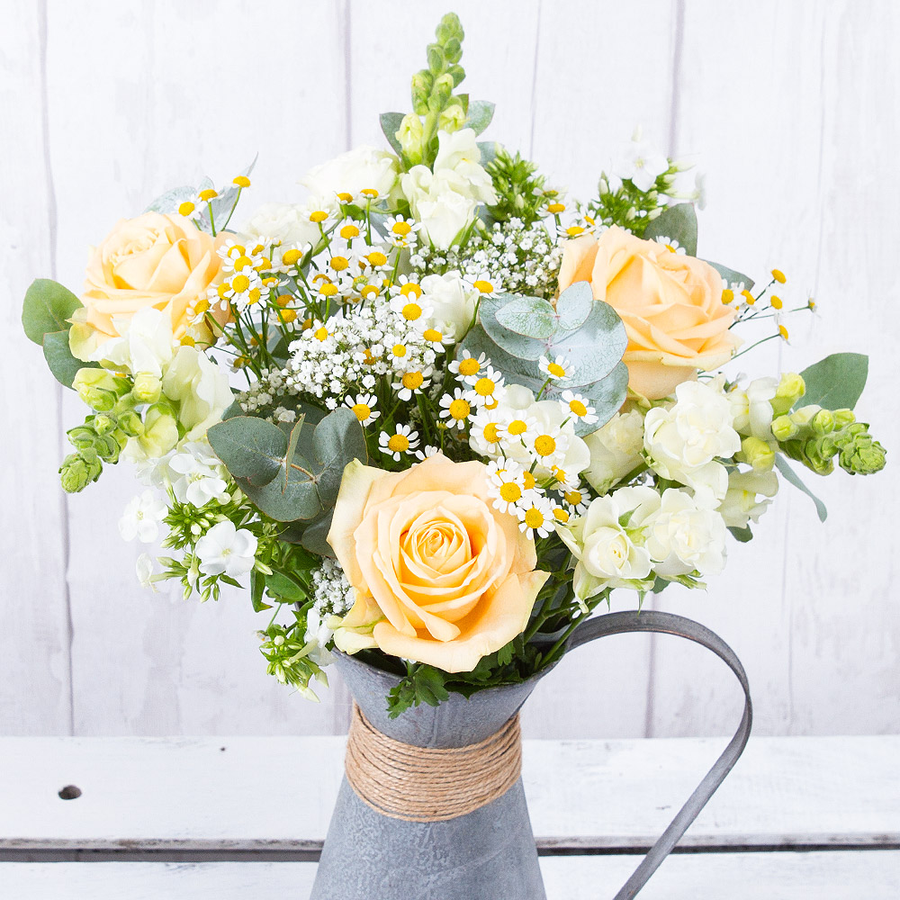 This classic arrangement features eye-catching peach Roses and white Snapdragon surrounded by white Phlox and Spray Roses.<br /><br />