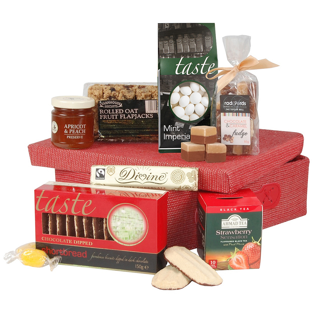 Iced Fruit Cake Fingers, Strawberry Tea and Chocolate Dipped Shortbread are a few of the yummy contents of this gift box.<br /><br />A brilliant gift for any occasion or to send to yourself as an extra special treat!