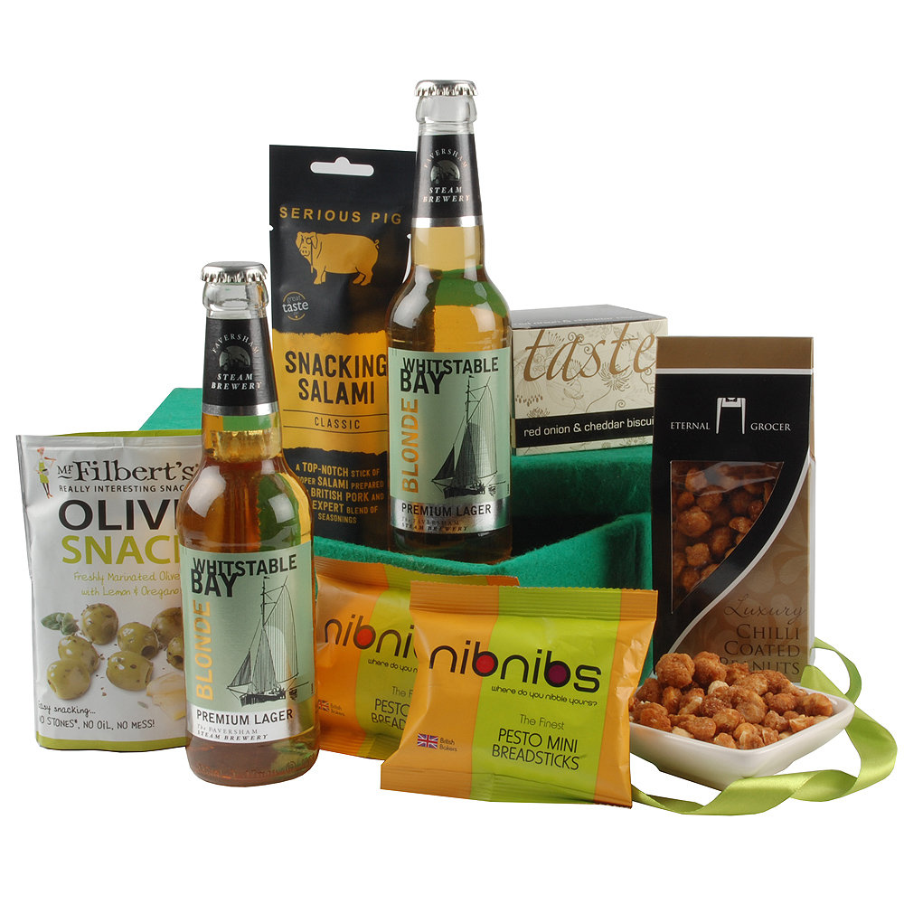 A variety of mouth-watering savoury goodies feature alongside two bottles of Whistable Bay Blonde Lager. 