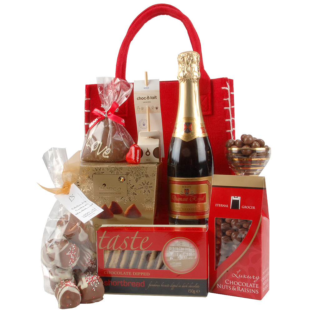 Suprise a loved one with this pretty red tote bag full of tempting chocolate treats and a bottle of Diamont Royal Blanc de Blancs Brut.<br/><br/>